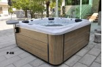 aurora 7 person hot tub white shell brown wood effect cabinet side view